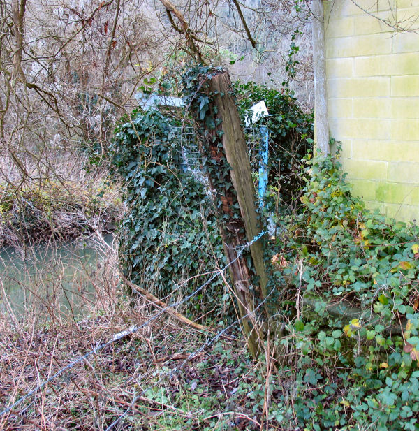 fencing removed by corner of building Freshford Mill