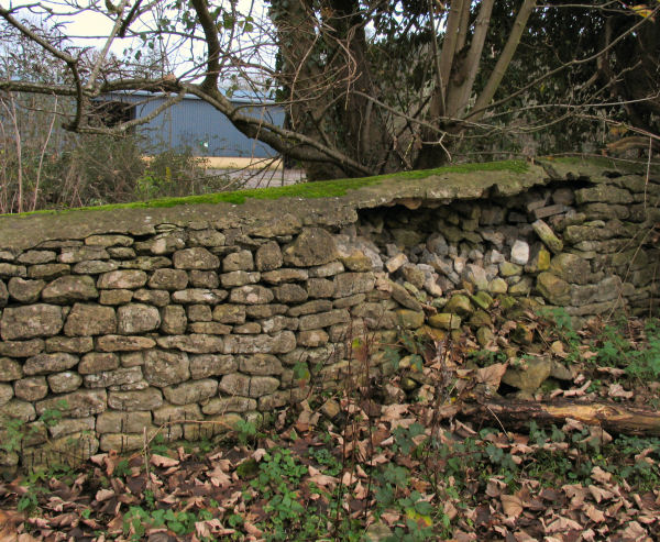 low stone wall at Freshford Mill no fencing to deter intruders