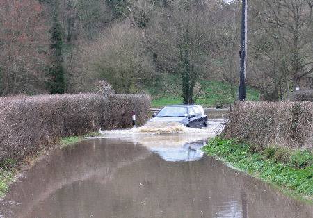 Car risking flood at Freshford Somerset 2008l