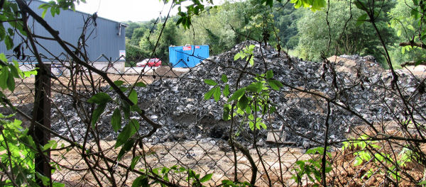 Huge pile of rubber and other contamination at Freshford Mill